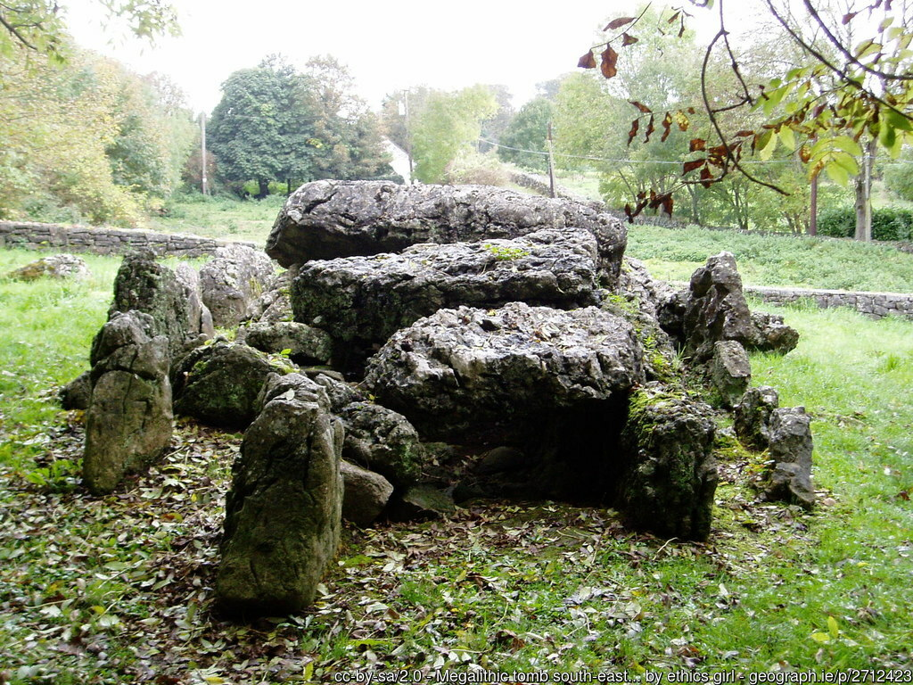 Ancient stone tomb in a field
