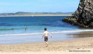 a child heads into the sea in Donegal