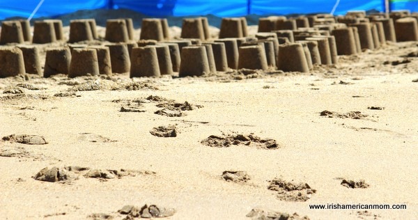 Rows of sand castles on a beach