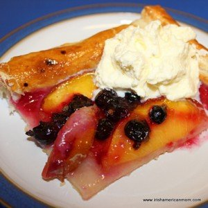 serving a slice of fruit galette with freshly whipped cream