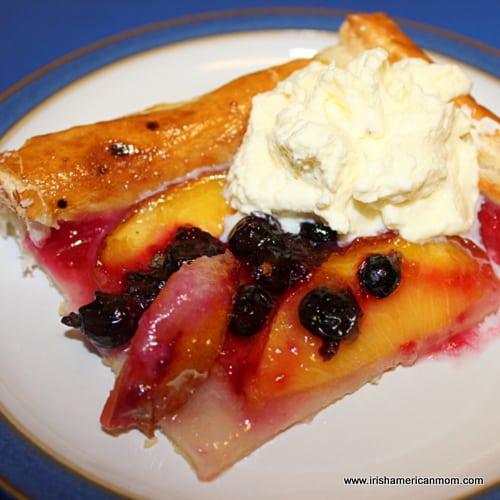 A dollop of cream on fruit pie