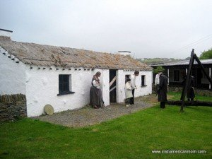 an Irish famine eviction scene by a thatched cottage from the Doagh Famine Village in Donegal