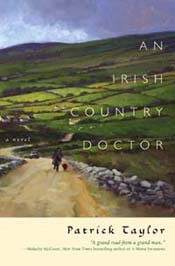 Book cover featuring a country road with a stone wall and green fields