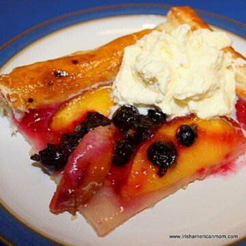 Slice of fruit galette served with cream