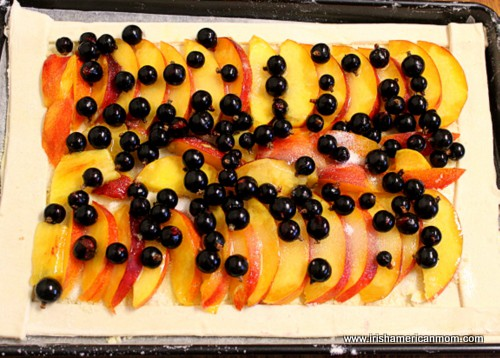 Nectarines and blackcurrants on an open face tart