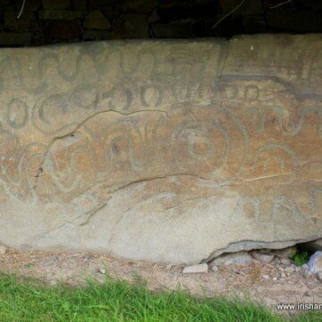 A stone with spirals and wave inscriptions at Knowth