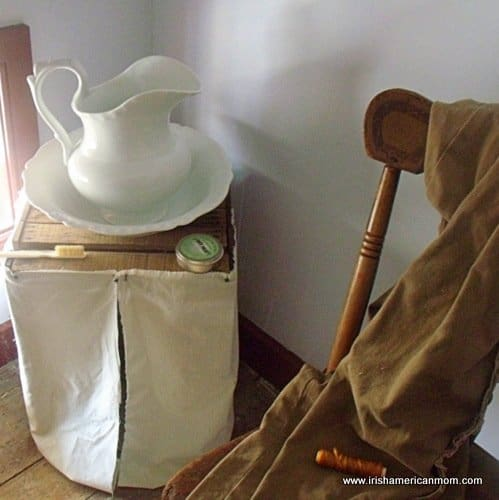 An old washstand with pitcher and bowl