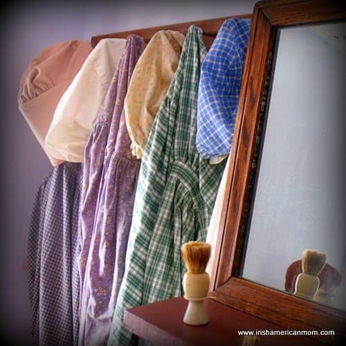 Dresses hanging on hooks at the Baltimore Irish Museum