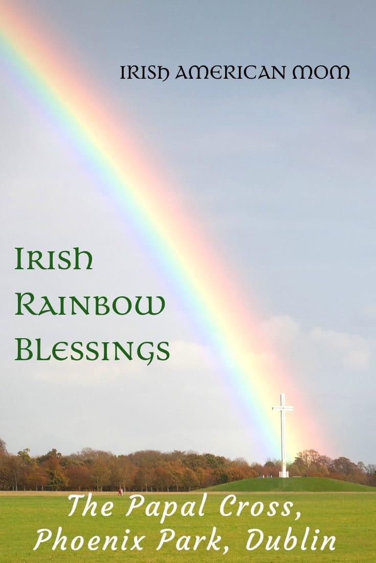 Rainbow falling on the Papal Cross in an Irish park
