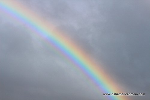 Irish Rainbow in cloudy sky