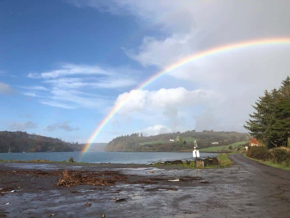 A rainbow arcs over Reen Pier In West Cork along the Wild Atlantic Way