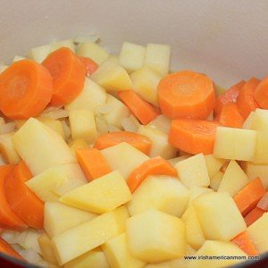A saucepan with diced carrot and rutabaga for carrot and rutabaga soup recipe