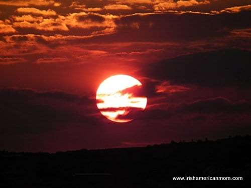 A large orange sun in a glowing red sky in Donegal Ireland