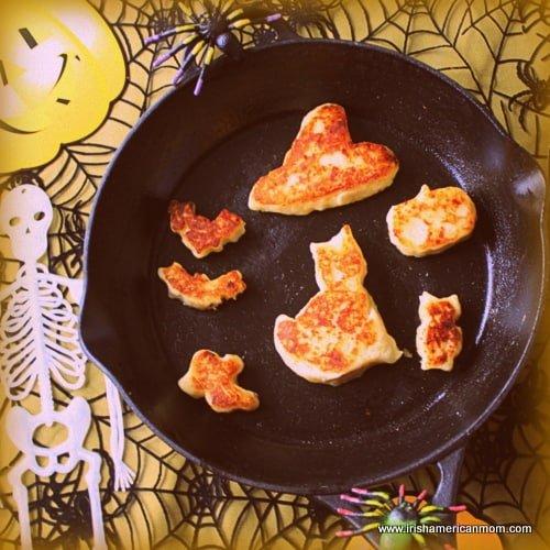 Black skillet with Halloween shaped Cheesy Irish Potato Cakes