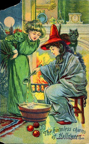 A witch stirs a pot by the fire