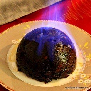 A Christmas pudding alight