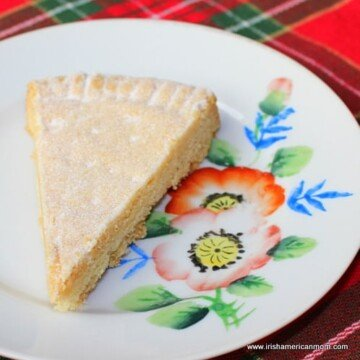 Caster sugar dredged over a slice of shortbread
