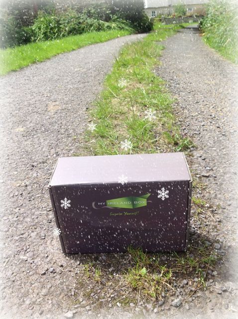 Brown gift box on a dirt road