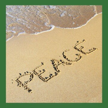 Letters etched in the sand by the shoreline