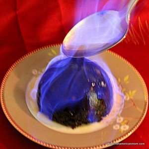 Plum pudding set alight with brandy