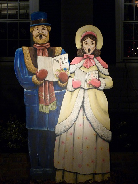 Carolers at Christmas made out of wood