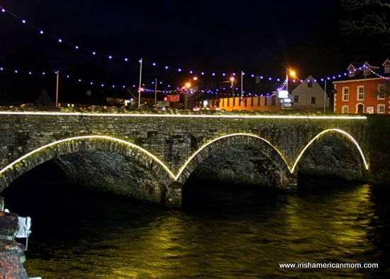Christmas lights illuminate the arched stone bridge in Ramelton County Donegal Ireland