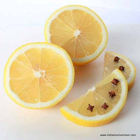 Studding a lemon with cloves for a hot whiskey