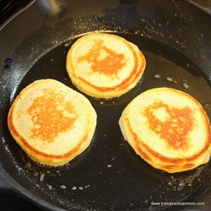 Golden cooked side of three drop scones in a black skillet