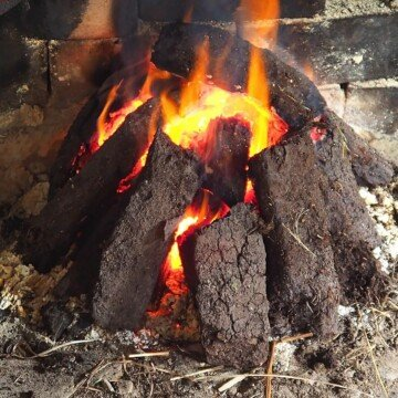 Sods of peat or turf burning in an open fire