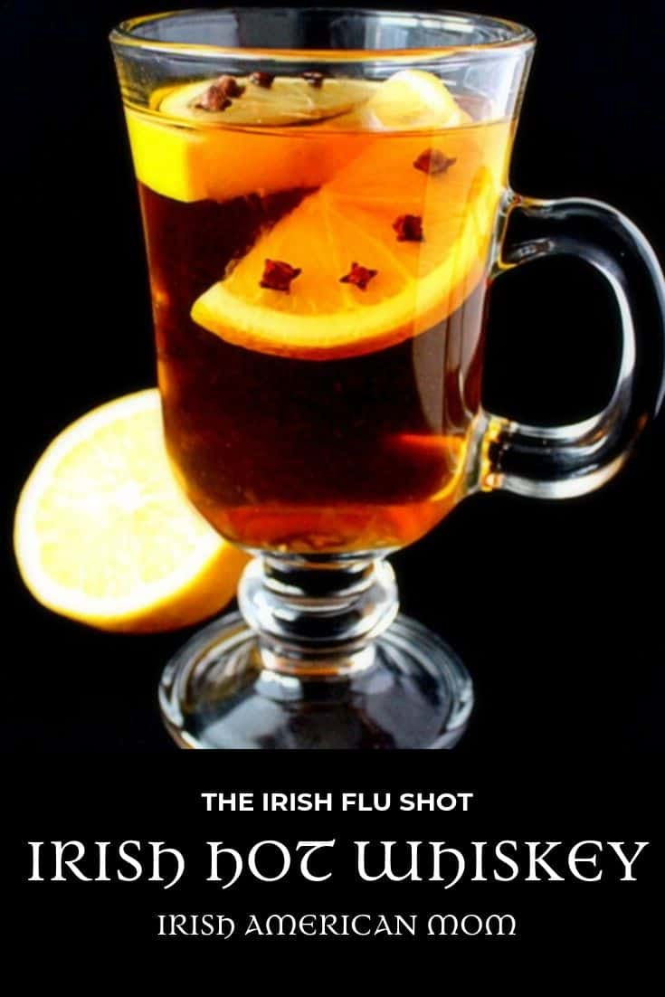 Lemon with studded cloves in a glass of Irish hot whiskey