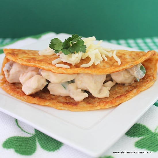 A folded thin boxty pancake filled with chicken and mushroom in a cheese sauce