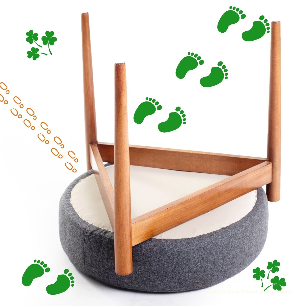 Upside down stool with green and orange footprints plus shamrocks