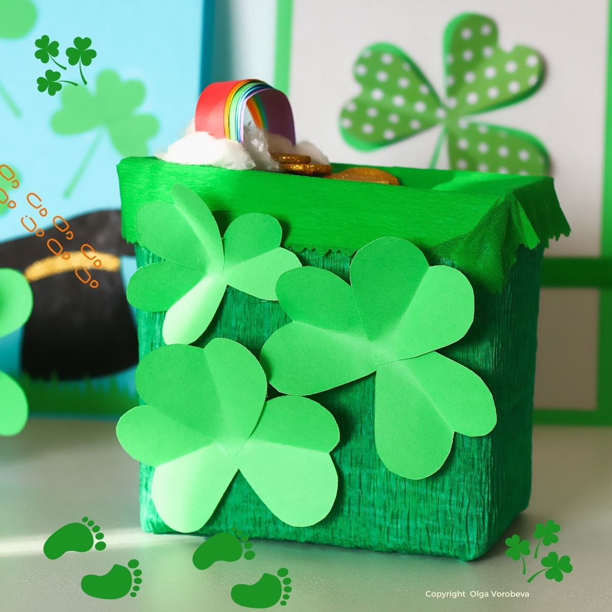 Box with shamrocks, a paper rainbow and golden coins