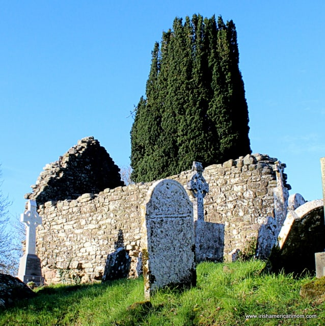 A ruined church on a bright day in a graveyard in County Cork