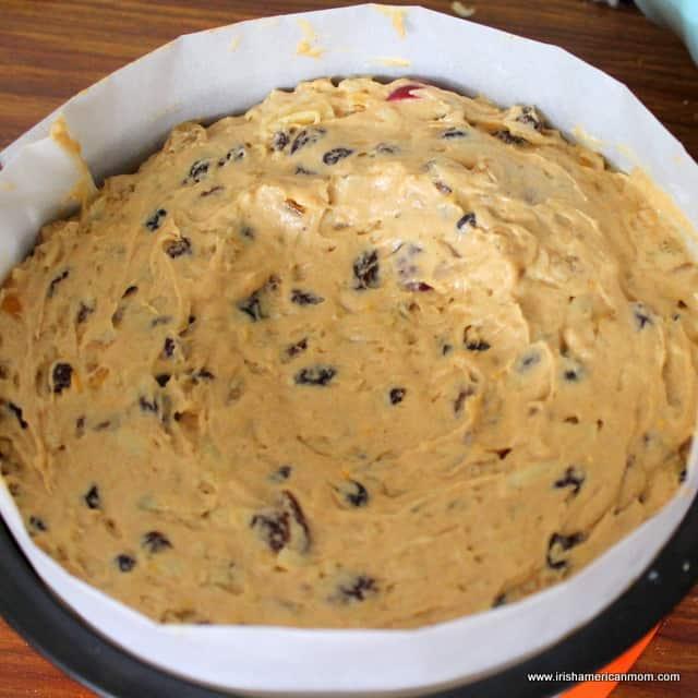 Dip in batter of fruit cake to prevent a peak rising