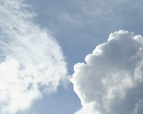Cloud formation shaped as if one cloud is blowing smoke