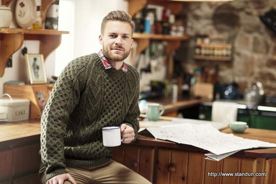 Men's Aran sweater in green cable knitting pattern