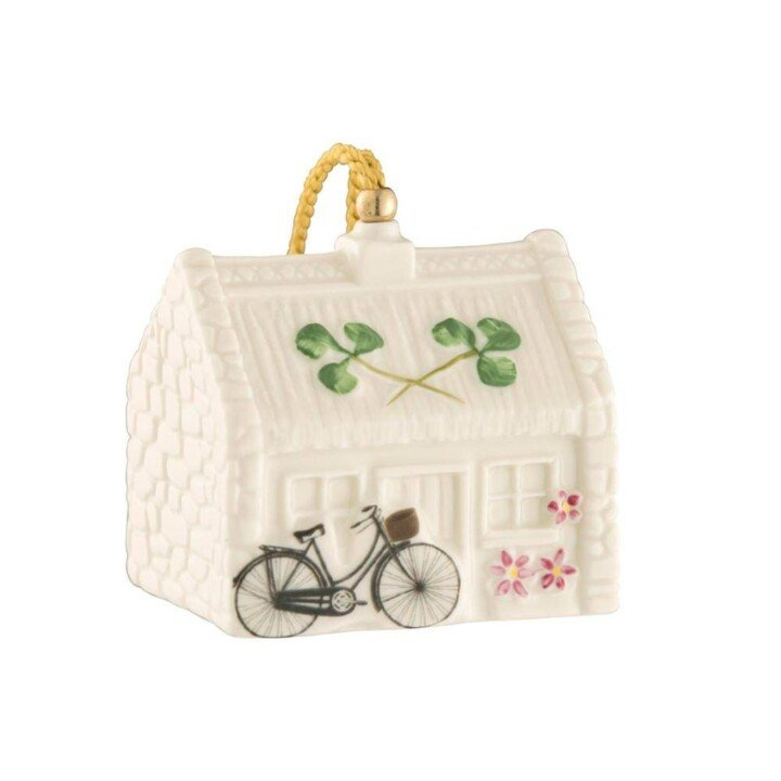 Porcelain cottage ornament with shamrock and bicycle design