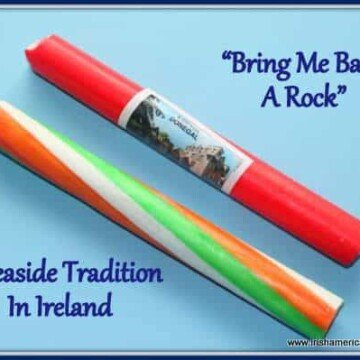A tricolor stick of Irish rock beside a pink and white stick of rock candy