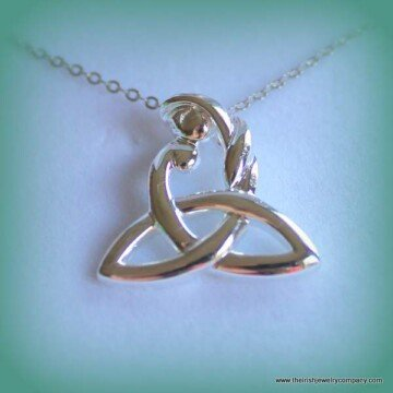 Mother holds a child as part of a Trinity knot necklace