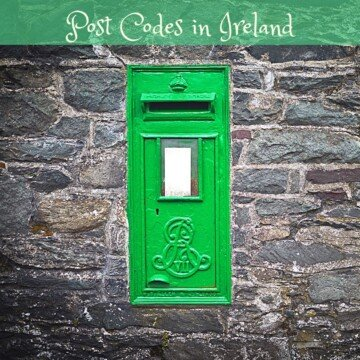 Green mail box in a wall with a text banner