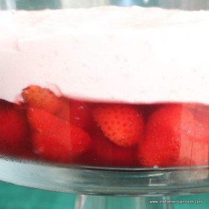 A layer of pink strawberry mousse in a trifle