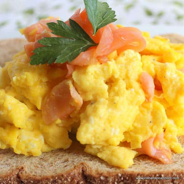 Close up view of scrambled eggs with smoked salmon