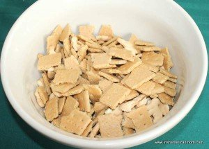 Pieces of graham crackers and animal crackers in a bowl