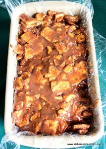 A loaf pan filled with chocolate biscuit cake mixture
