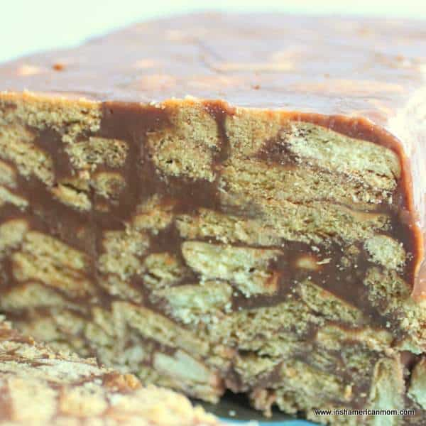 Inside of a chocolate biscuit cake showing layers of biscuit pieces and chocolate