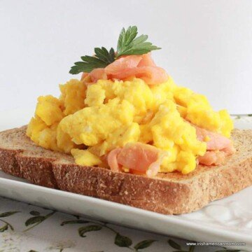 Toast topped with scrambled eggs and smoked salmon