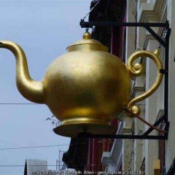 A golden tea pot over a tea house