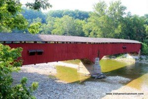 Long double span red wooden covered bridge