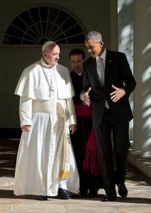 The Pope and the US President walking together in the White House